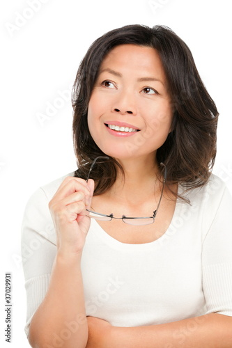 Thinking middle aged asian woman