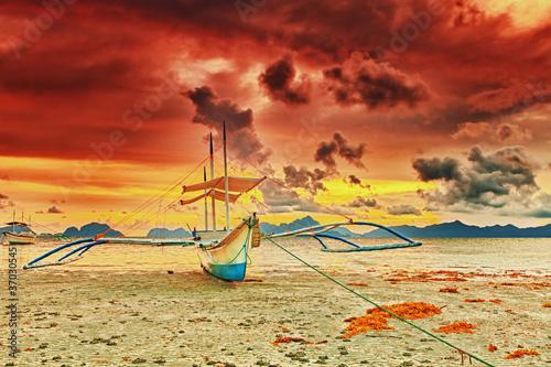 Boat at sunset - 37030545