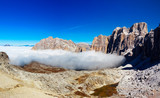 Dolomities -  mountain peak emerges from the clouds
