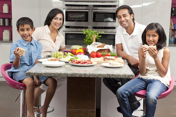 Asian Indian Parents Children Family Eating Healthy Food in Kitc