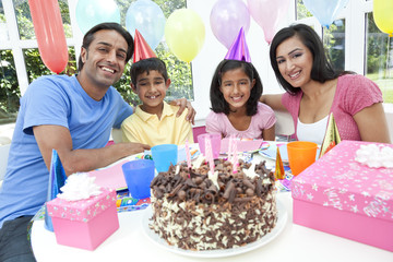 Asian Indian Family Celebrating Birthday Party WIth Chocolate Ca