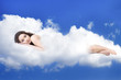 beautiful woman lying on clouds