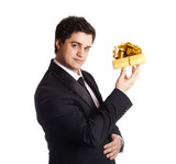 A man holding present box in formal black tux poster