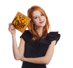 Red-haired girl in dress with present box at white background.