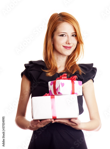 Beautiful red-haired girl with present boxes.