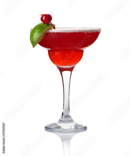 Glass of alcohol cocktail with lime and cherry isolated