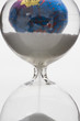 Hourglass, globe in background