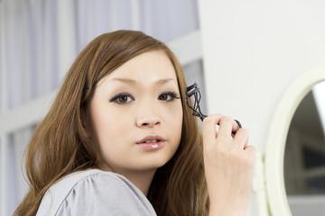 Beautiful woman apply makeup