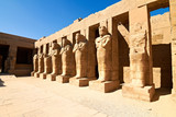 Row of Pharaoh statues in linear perspective poster
