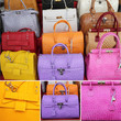 collage with colorful leather handbags collection