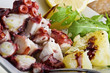 octopus salad with lemon slice and potatoes