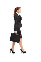 Businesswoman walking with a briefcase in her hand