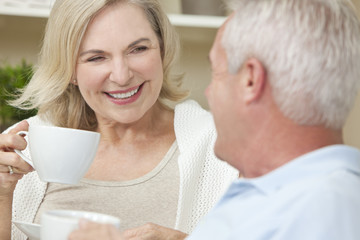 Happy Senior Man & Woman Couple Drinking Tea or Coffee