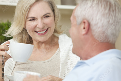 Happy Senior Man & Woman Couple Drinking Tea or Coffee - 37051719