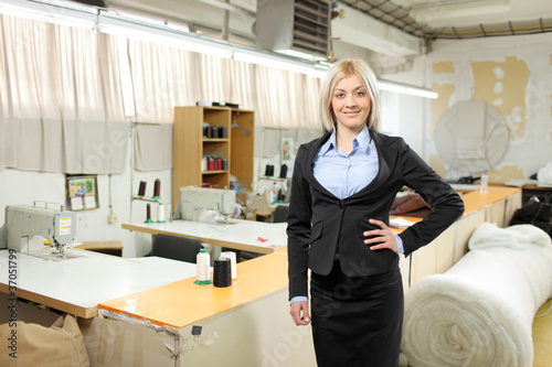 Female owner of a small business standing inside a factory