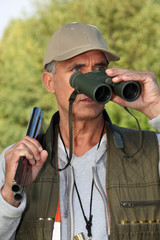 Hunter looking through binoculars