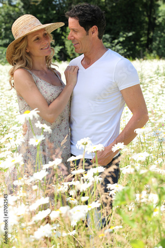 Couple in field of flowers.