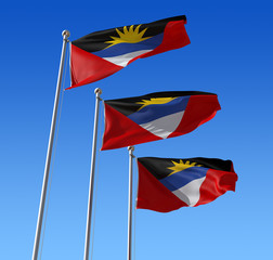 Three flags of Antigua and Barbuda  against blue sky.