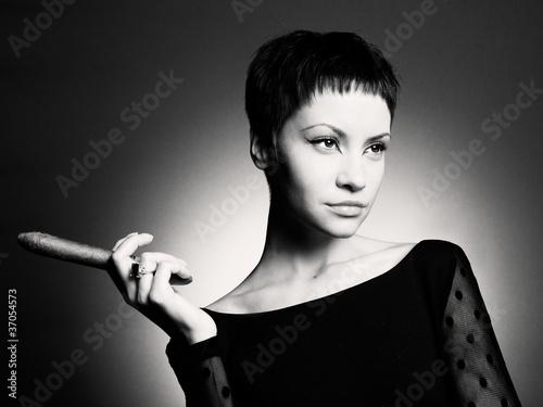 Leinwandbild Motiv Stylish woman with cigar