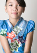 Asian Girl holding Origami Flowers