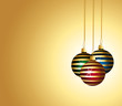 Colorful striped christmas ornaments. Golden background.