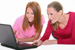 Two young woman with laptop