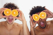 Young men have fun with oranges