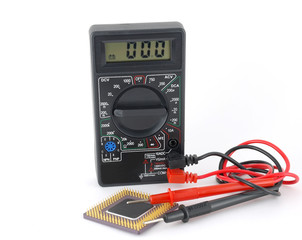 Multimeter and microprocessor over white