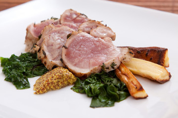 Sliced pork with spinach and parsnips