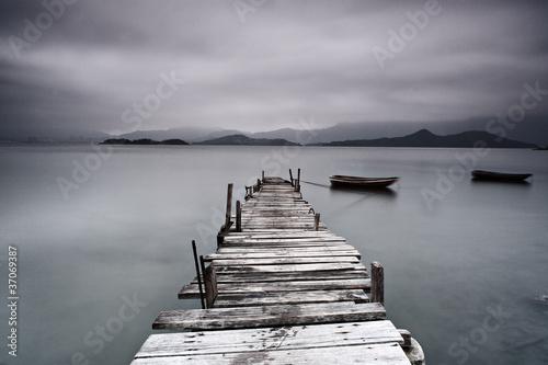 Fototapeta pier and boat, low saturation