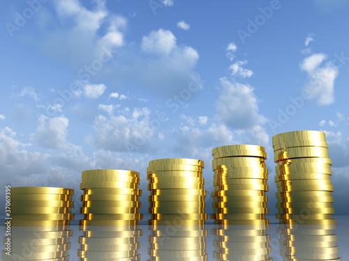 Golden coins on a background of the blue sky