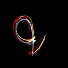 Letter Q made from brightly coloured neon lights