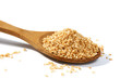 Sesame grains in large wooden spoon