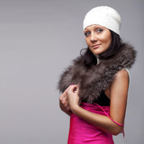 Beautiful girl in fur cape