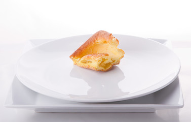 Yorkshire pudding on white plates