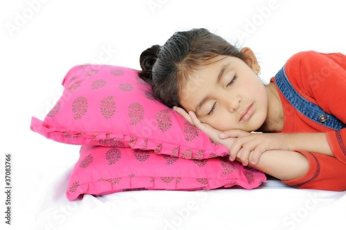 Indian Girl sleeping over pillow.