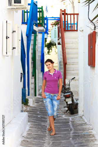 tourist in a treet of mykonos