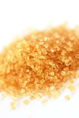 yellowish brown sugar over white background