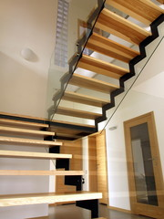 Wooden glass staircase in modern interior