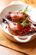 Roasted duck legs with rosemary and cloves