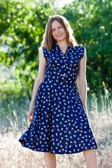 Pretty girl in a field.