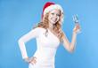 Young beautiful Santa girl drinking a champagne