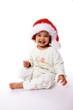 enfant avec chapeau de père noël