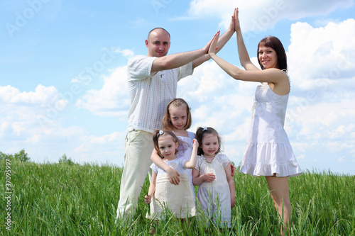 family with children in summer day outdoors