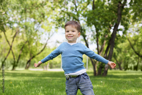 Portrait of a little boy outdoors