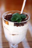 close-up dessert tiramisu in glass bowl decorated with mint
