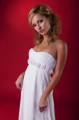 Bride young blond fashion model in white dress
