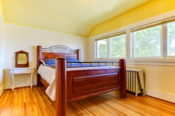 Bedroom with ots of windows and wood floor.