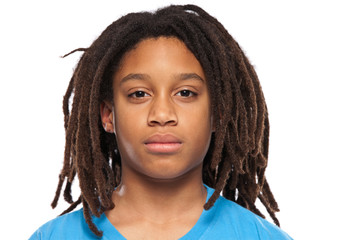close up portrait of a young rasta boy