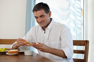 Smiling Man Having Breakfast